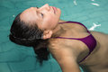 Pregnant woman floating in the pool Royalty Free Stock Photo