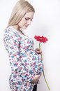 Pregnant woman with flower Stock Images