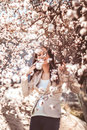 Pregnant woman in the flowering branches garden Stock Image