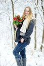 Pregnant woman with flowers in winter forest Royalty Free Stock Photography