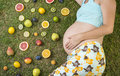 Pregnant woman with fruit Royalty Free Stock Photo