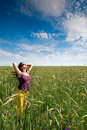 Pregnant woman on green grass field under blue sky Royalty Free Stock Photo