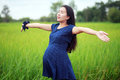Pregnant woman on green meadow Stock Image