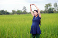 Pregnant woman on green meadow Royalty Free Stock Photo