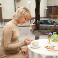 Pregnant woman having breakfast cappuccino and cookies young happy cup of Royalty Free Stock Photos