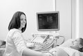 Pregnant woman having ultrasonic scanning at the clinic