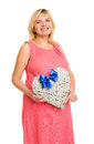 Pregnant woman with heart and blue bow isolated Royalty Free Stock Photography