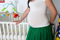 Pregnant woman in her baby room Royalty Free Stock Photo