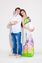Pregnant woman with her husband beautiful women posing in studio Stock Image