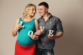 Pregnant woman with her husband portrait of a happy young women Stock Photo