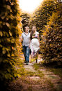 Pregnant woman and her husband walking women in autumn park Royalty Free Stock Image