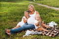 Pregnant woman with her kids beautiful blond women enjoying older company mother outdoors in sunlight mother s day concept Royalty Free Stock Photos