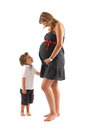 Pregnant woman and her son Stock Photos