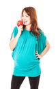 A pregnant woman is holding an apple Stock Photo