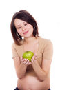 Pregnant woman holding an apple in her hands Royalty Free Stock Photo