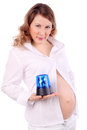 Pregnant woman holds blue flasher Stock Photo