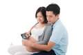 Pregnant woman with husband holding ultrasound scan of unborn ch women child photo Stock Image
