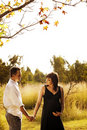 Pregnant woman and husband outdoors Royalty Free Stock Photography