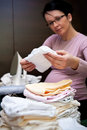Pregnant woman ironing Royalty Free Stock Photography