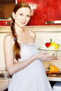 Pregnant woman in kitchen making a salad Stock Photography
