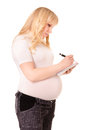 Pregnant woman makes notes Stock Photography
