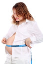 Pregnant woman measures stomach  by centimeter tape Royalty Free Stock Image