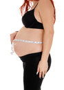 Pregnant woman measuring belly. Royalty Free Stock Photo