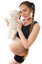 Pregnant woman mum  with toy Teddy bear Stock Photo