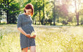 Pregnant woman on nature in chamomile field Royalty Free Stock Photo