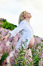 Pregnant woman at one with nature Stock Photos