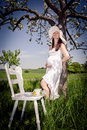 Pregnant woman outdoor portrait of a young Stock Photography