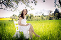 Pregnant woman outdoor portrait of a young Stock Photo
