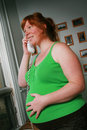 Pregnant woman on phone Royalty Free Stock Photography