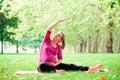 Pregnant Woman Playing Yoga At...