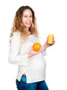 Pregnant woman with pretty stomach holding orange Royalty Free Stock Photos