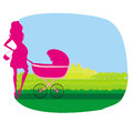 Pregnant woman pushing a stroller Stock Photography
