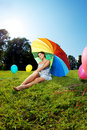 Pregnant woman rainbow umbrella Stock Image