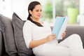 Pregnant woman reading attractive a book at home Royalty Free Stock Photo