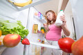 Pregnant woman and refrigerator with health food vegetables fruits Stock Photo