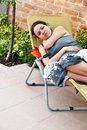 Pregnant woman relaxed happy smiling young caucasian lying in outdoor chair outdoor Royalty Free Stock Photos