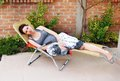 Pregnant woman relaxed happy smiling young caucasian lying in outdoor chair outdoor Royalty Free Stock Images