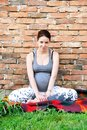 Pregnant woman relaxed happy smiling young caucasian sitting by brick wall outdoor Stock Images
