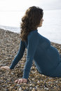 Pregnant Woman Relaxing On Beach Royalty Free Stock Photo