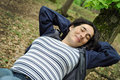 Pregnant woman relaxing in the forest Royalty Free Stock Photo