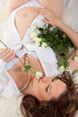Pregnant woman with roses Stock Photos