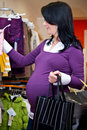 Pregnant woman shopping Royalty Free Stock Photo