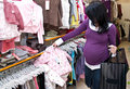 Pregnant woman shopping Stock Photos