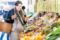 Pregnant woman shopping groceries on farmers market Royalty Free Stock Photo