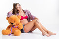 Pregnant woman is sitting with big teddy bear Royalty Free Stock Photo