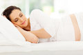 Pregnant woman sleeping beautiful young peacefully in bed Royalty Free Stock Photography